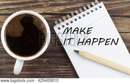Make It Happen Text On The Notebook With Coffee On Wooden Background