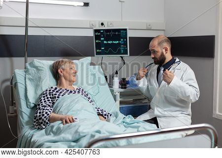 Senior Woman Laying In Bed Inhale And Exhale With Help From Oxygen Tube, Getting Intravenous Treatme