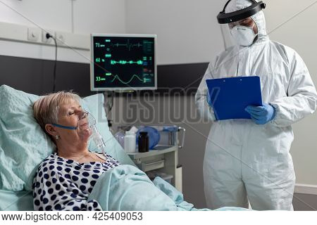 Sick Senior Patient Getting Intravenous Medicine From Iv Drip Bag Laying In Bed, Inhale And Exhale T