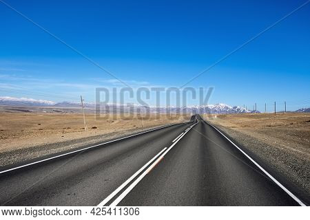 Beautiful View Of Chuya Highway In Chuya Steppe, Empty Road And Blue Sky In Altai Republic, Siberia,