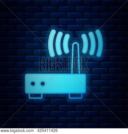 Glowing Neon Router And Wi-fi Signal Icon Isolated On Brick Wall Background. Wireless Ethernet Modem
