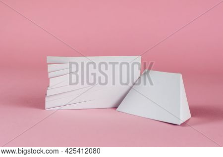 White Blank Rectangle With Cut Strips And Trapezoid On Pink Background. Random Scissor-cut Slip Of P