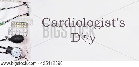 Medical Congratulatory Banner With The Inscription Cardiologists Day On White With An Ecg, Tonometer