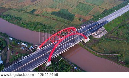 Aerial View Of The Kalikuto Bridge, An Iconic Red Bridge At Trans Java Toll Road, Batang When Sunris