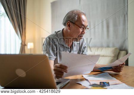 Depressed Asian Senior Elderly Male Feel Worry About Financial Problem. Stressed Desperate Older Man