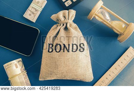Money Bag With The Word Bonds. A Bond Is A Security That Indicates That The Investor Has Provided A