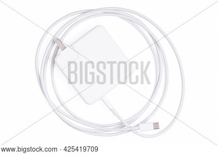 Isolated Adapter Charger. Top View Charger Cord And Plug For Gadget On White. Usb Cable Connector Wi