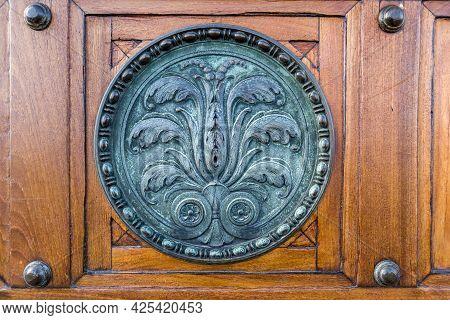 Copenhagen, Denmark - Oct 21, 2018: Bronze Metal Bas-relief Circular Disk Of Intricate Floral Design