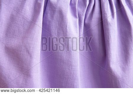 Beautiful Nude Violet Fabric Texture With Folds And Contrasting Shadows . Draped Background Of Purpl