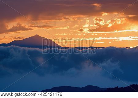 Volcano Pico Del Teide Rising From The Clouds Within Sunset. Tenerife Canary Islands, Spain