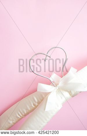 Wedding Satin Hangers. Two Empty White Soft Clothes Hangers On A Bright Pink Background. Creative Fl
