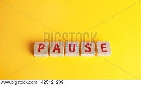 Wooden Blocks With The Word Pause. Break Time Concept. A Break During Work. Time To Relax And Rechar