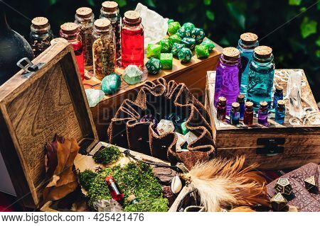 Rpg Gaming Scene With A Leather Dice Bag, Magic Potions In Glass Bottles, Crystals, And Green Dice.