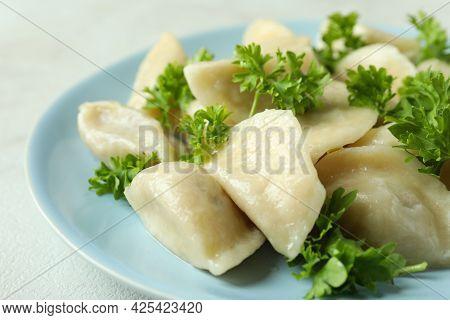 Concept Of Tasty Food With Vareniki Or Pierogi On White Textured Table