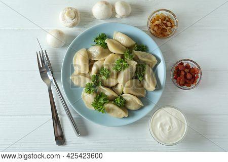Concept Of Tasty Food With Vareniki Or Pierogi On Wooden Table