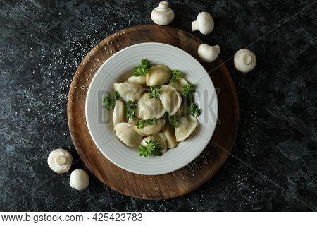 Concept Of Tasty Food With Vareniki Or Pierogi On Black Smokey Table