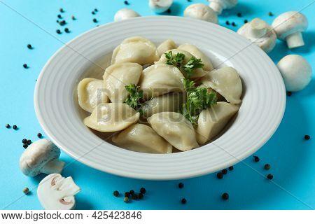 Concept Of Tasty Food With Vareniki Or Pierogi On Blue Background