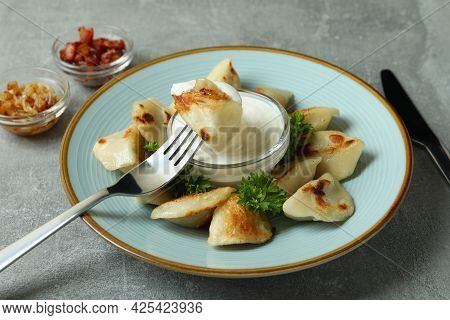 Concept Of Tasty Food With Vareniki Or Pierogi On Gray Textured Background