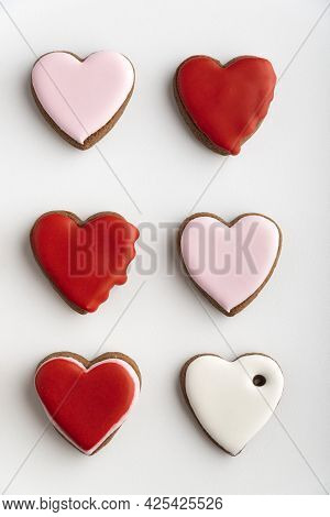 Gingerbread Cookies With Sugar Icing On White Background. Vertical Frame.