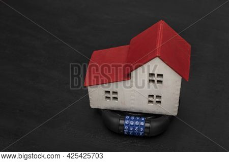 Combination Lock And The Model Of House . Property Private Protection . Security Concept
