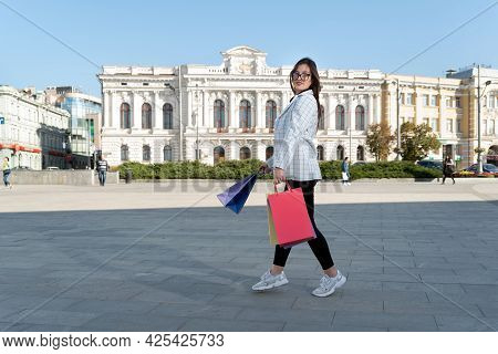 Young Woman After Successful Shopping Walks Around City With Shopping Packages.