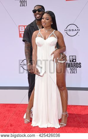 LOS ANGELES - JUN 27:  Megan Thee Stallion and Pardi {Object} arrives for the 2021 BET Awards on June 27, 2021 in Los Angeles, CA