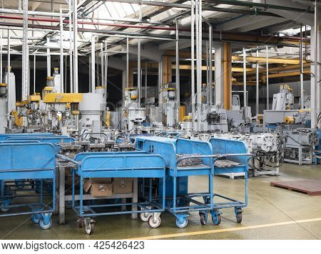 Minsk, Belarus - 30 May 2021: Indoor Environment Of The Factory Floor. Blue Wagons With Metal Workpi