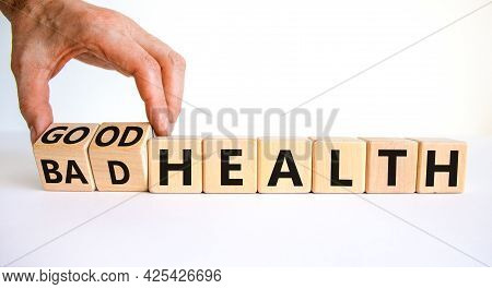 Good Or Bad Health Symbol. Doctor Turns Wooden Cubes And Changes Words Bad Health To Good Health. Be