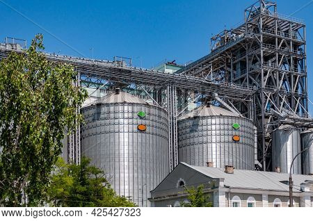 Silos For Storing Cement Used In The Construction. Cement Factory. Metal Tower Silos Of The Industri