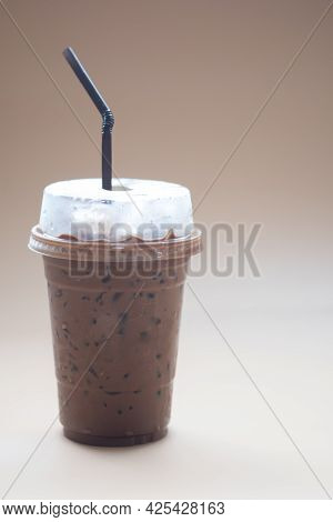Iced Mocha Coffee In Plastic Cup With Black Straw