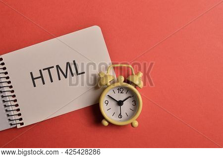 Clock And Memo Note Written With Text Html Or The Hypertext Markup Language