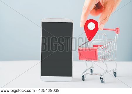 Human's Hand Holding Check In Paper Cut Sign, White Mobile Phone With Clipping Path On Touchscreen A