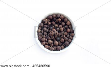 Bowl Of Allspice Isolated On White Background Top View. Jamaica Pepper Or Allspice Peppercorns