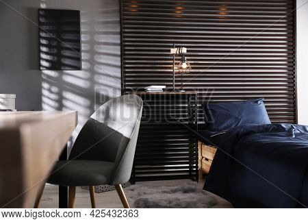 Wooden Bed With Soft Silky Bedclothes In Room