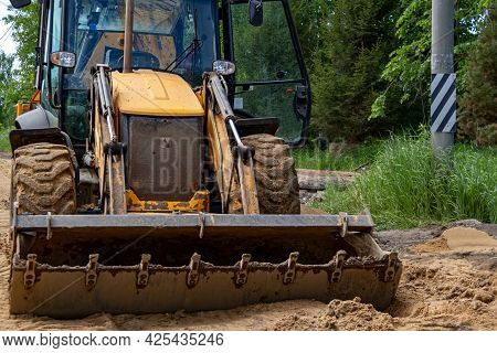 Bulldozer Builds Road. Grader In A New Highaway Construction. Construction Machinery.