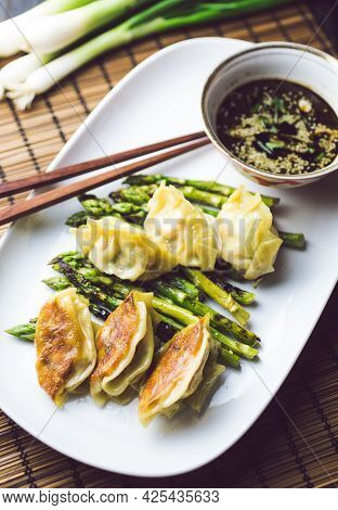 Gyoza Dumplings With Grilled Asparagus