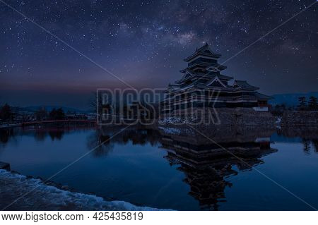 Old Castle In Japan. Matsumoto Castle Against Night Sky. Castle In Winter With Milky Way On Sky .tra