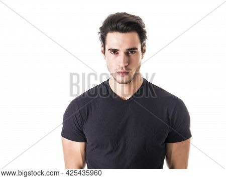 Handsome Young Man Looking At Camera In Studio