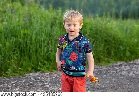 Jolly Child In The Colorful Dress Off Down The Road