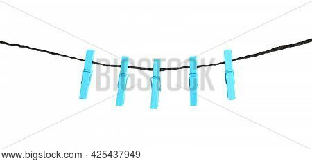Many Light Blue Wooden Clothespins On Rope Against White Background