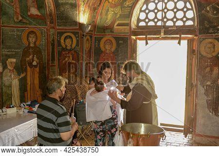People During A Baptism On The Church Of Panagia Phorviotissa At Nikitari On Cyprus Island
