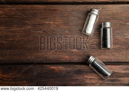 Flat Lay Composition With Natural Dental Floss On Wooden Background. Space For Text