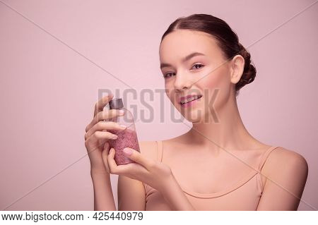 Portrait Of Beautiful Young Woman Isolated On Light Pink Studio Background. Concept Of Female Beauty