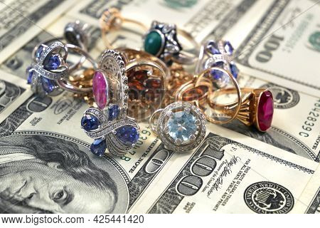 Money And Jewelry, Pawn Shop And Buy And Sell Precious Metals Concept, Golden Rings, Necklace Bracel