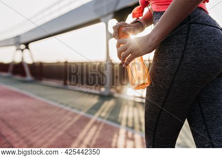 Sporty Girl Drinking Water After Long Marathon. Good-looking Female Model Preparing For Sport Compet