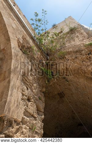Remains Of The Fortress Walls In The Courtyard Of The Crusader Fortress Of The Old City Of Acre In N