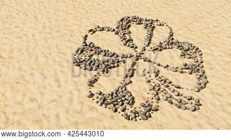 Concept conceptual stones on beach sand handmade symbol shape, golden sandy background, four-leafed clover sign. 3d illustration metaphor for good luck, faith, hope, tradition, nature growth, spring