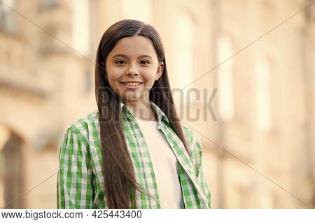 Young And Carefree. Happy Child Smile Outdoors. Beauty Look Of Child Girl. Casual Style. Trendy Stre