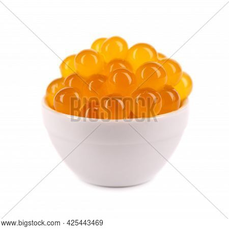 Red Tapioca Pearls For Bubble Tea Isolated On White Background. Tapioca Pearls In White Ceramic Spoo