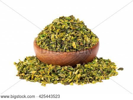 Dried Green Paprika Flakes With Seeds In Wooden Bowl, Isolated On White Background. Chopped Jalapeno